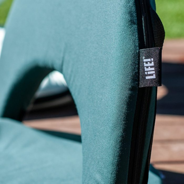 A close up of the LiFE! branded tag on a forest green cushion recliner portable beach chair