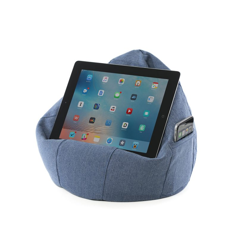 A tablet sits landscape on a denim blue iCrib. A phone sits in the storage pocket