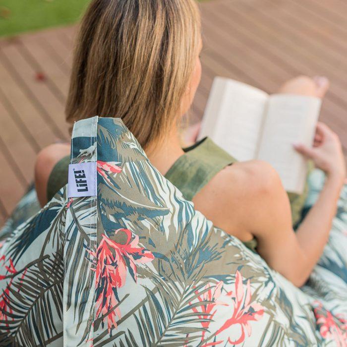 a women reads on a life waikiki luna bean bag