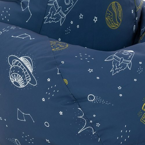 Close up of space buddy space print beanbag showing white planets and rockets on a blue background