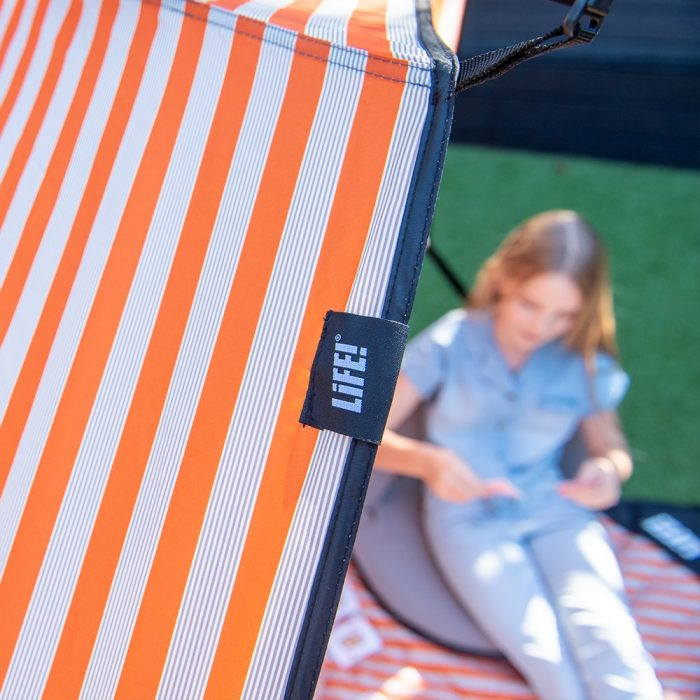 Close up of the LiFE! branded tag and alternating stripes on the retro airlie sun shelter