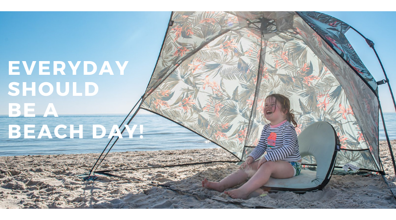 Banner shows a toddler laughing in a floral print easy pop up beach shelter. Text reads everyday should be a beach day