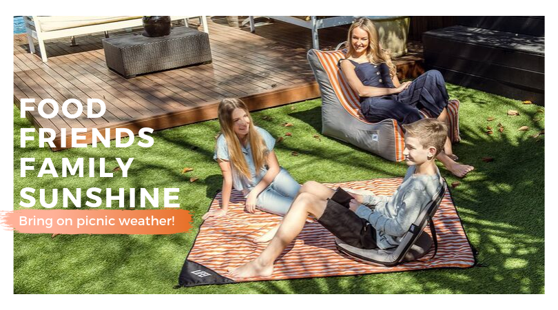 Banner shows a family picnicing in the backyard on orange striped retro products. Text says Food, Family, Friends, Sunshine, bring on picnic weather!