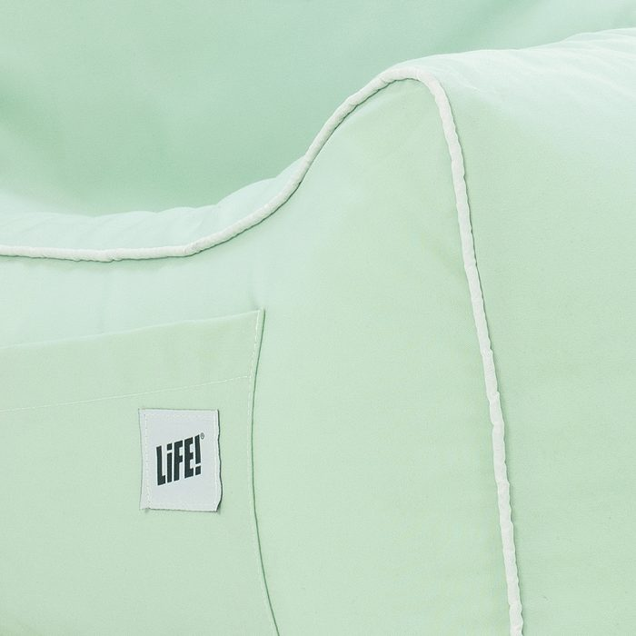close up of the white piping trim on the tropical green coastal lounger bean bag