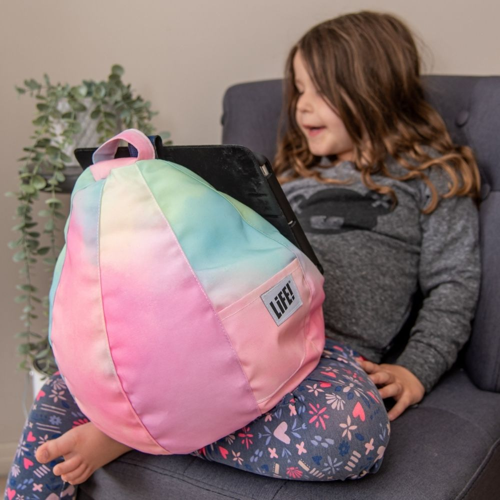 pastel tie dye print iCrib in use with a small girl holding an iPad