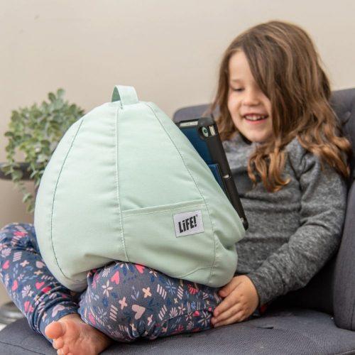 Tropical green iCrib bean bag in a child's lap holding an iPad