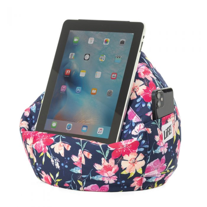 Kalaii iCrib with an iPad on it and a phone in the storage pocket