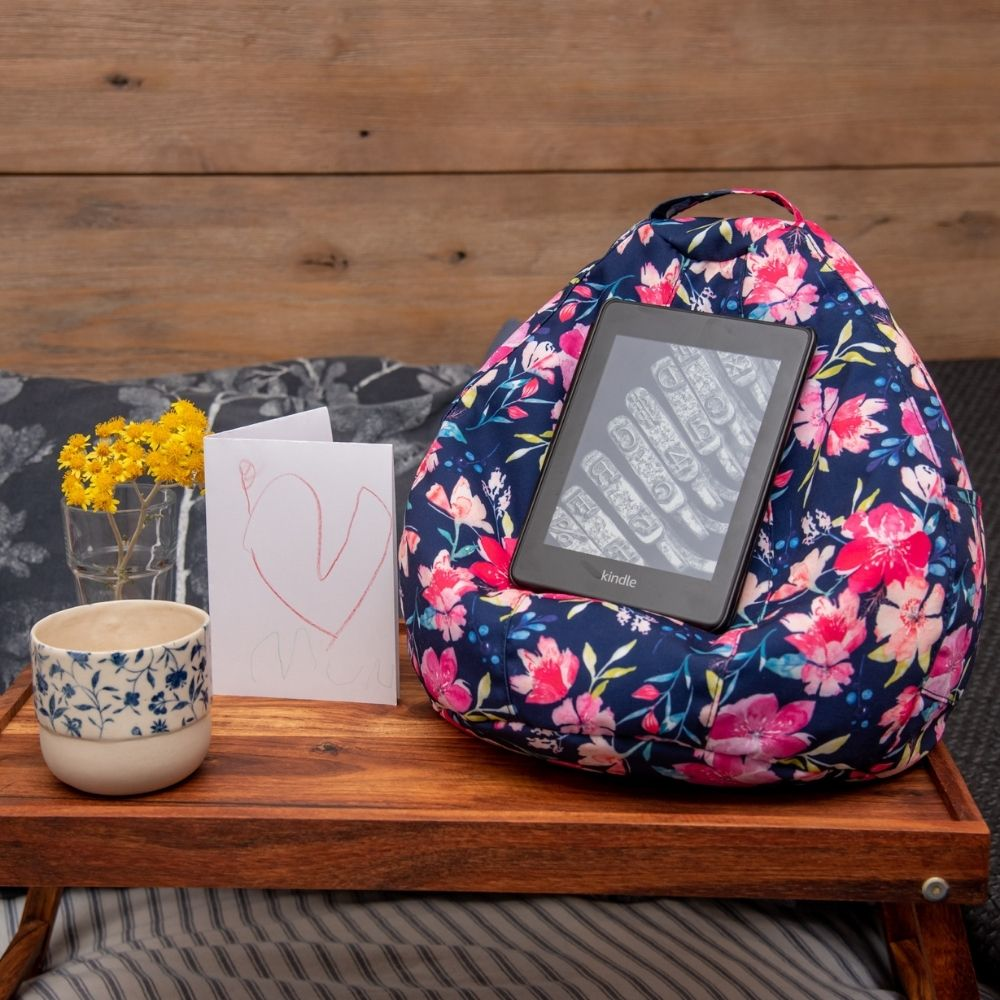 Kalaii iCrib on a lap table with a love heart card, kindle and coffee for breakfast in bed